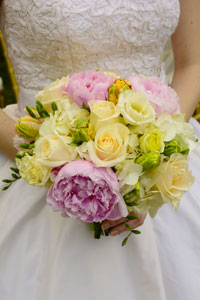 bride in wedding gown holding bouquet
